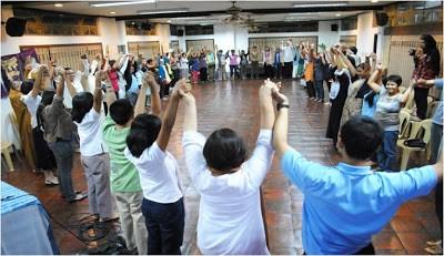 Dialogue Circle at UP - hands raised
